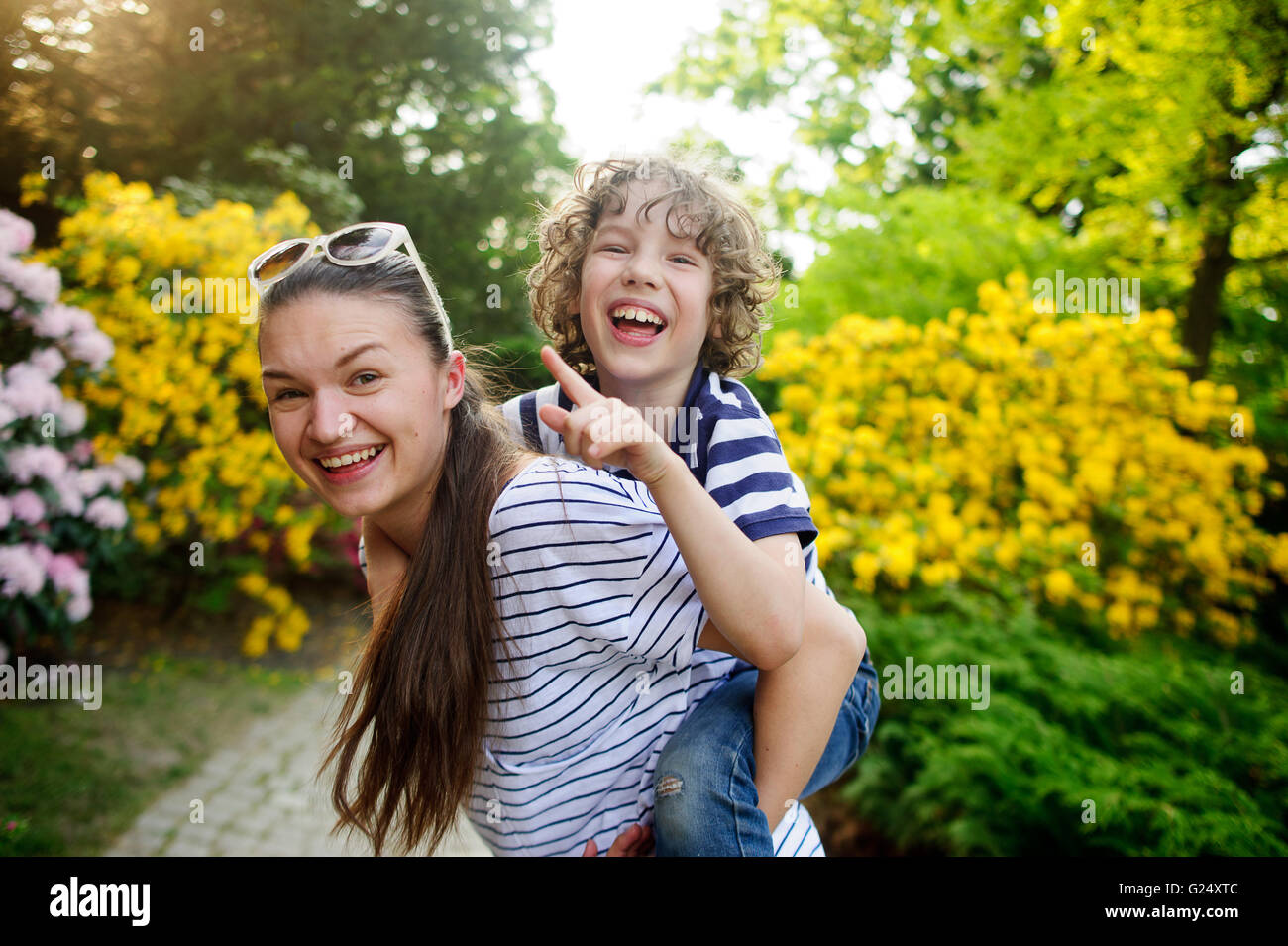Young woman playing with her son - Stock Image