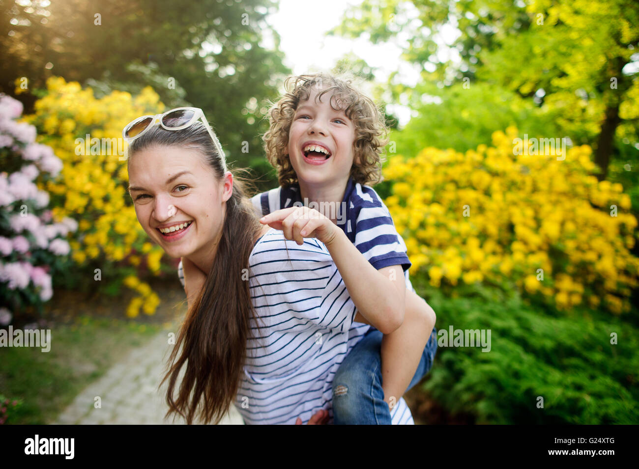 Woman with her son on a walk in the park - Stock Image