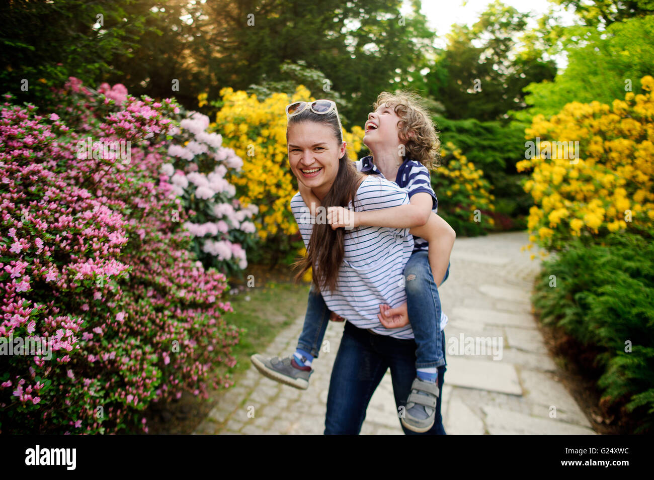 Boy on a walk with her older sister - Stock Image