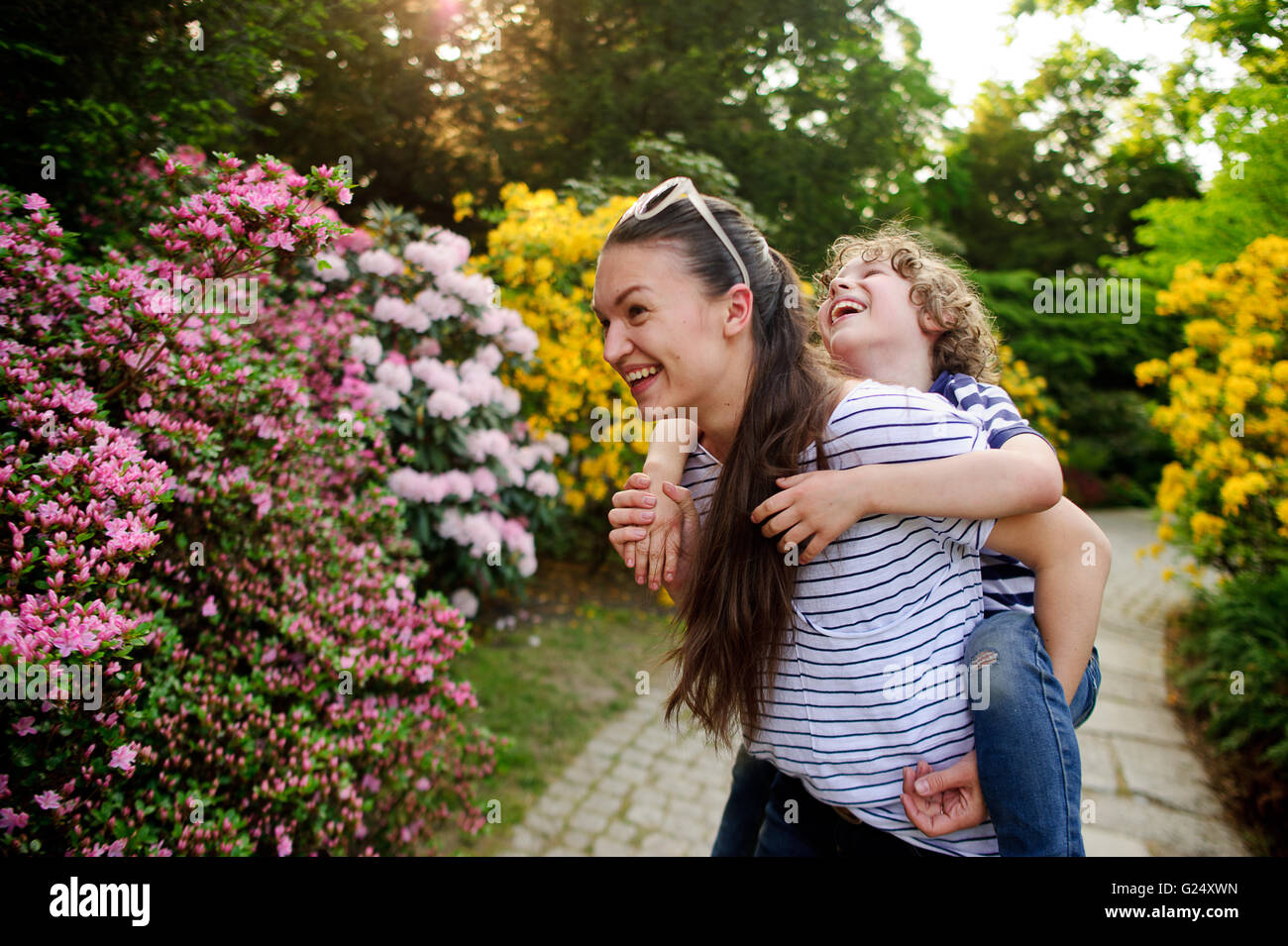 Woman playing with her son on nature - Stock Image