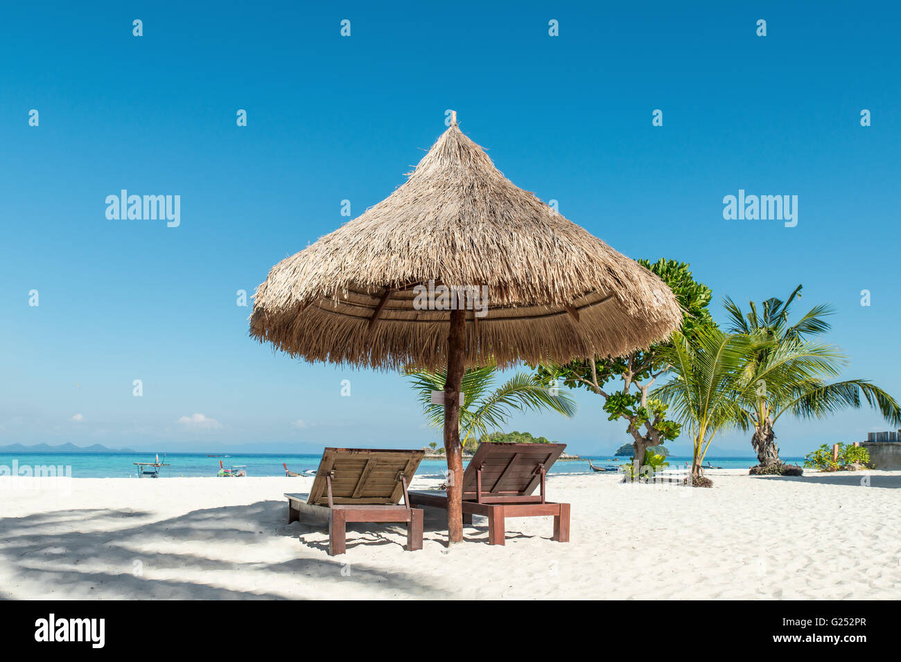 Summer, Travel, Vacation and Holiday concept - Beach Chairs and Umbrella on island in Phuket, Thailand - Stock Image