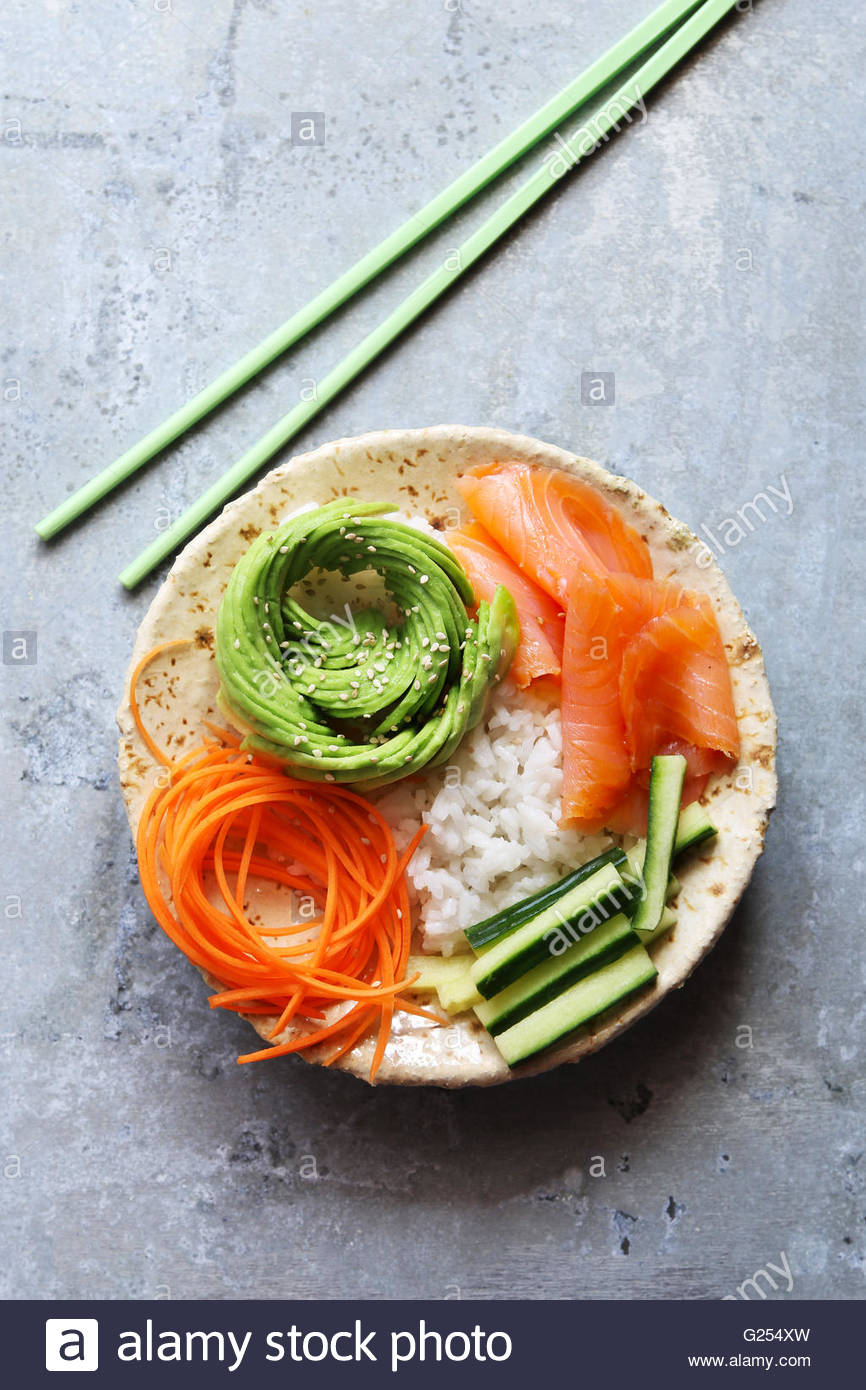 Sushi bowl with avocado rose.Top view. - Stock Image