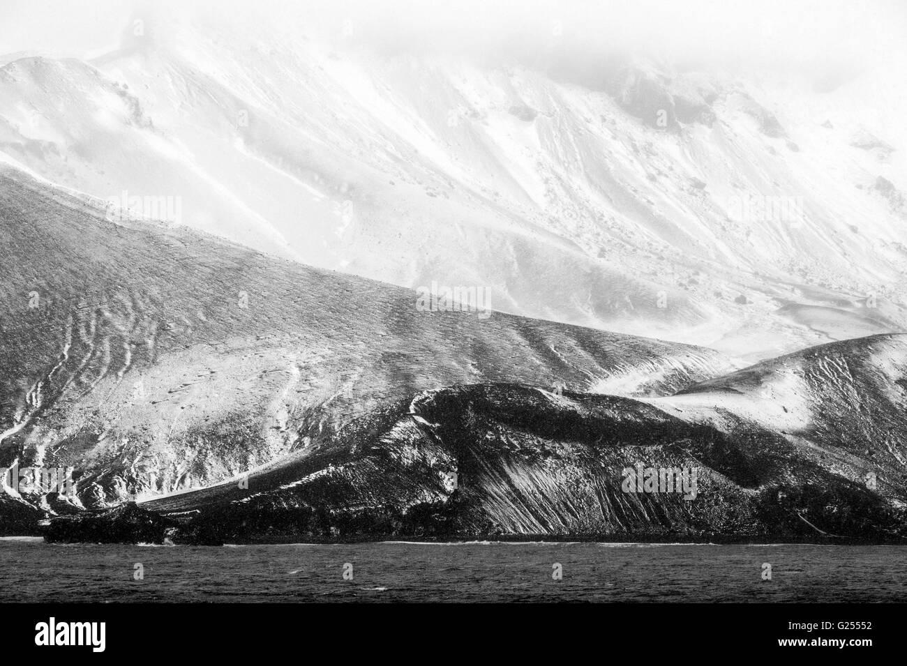 Mountains inside the caldera Deception Island, South Shetland Islands, Antarctica - Stock Image