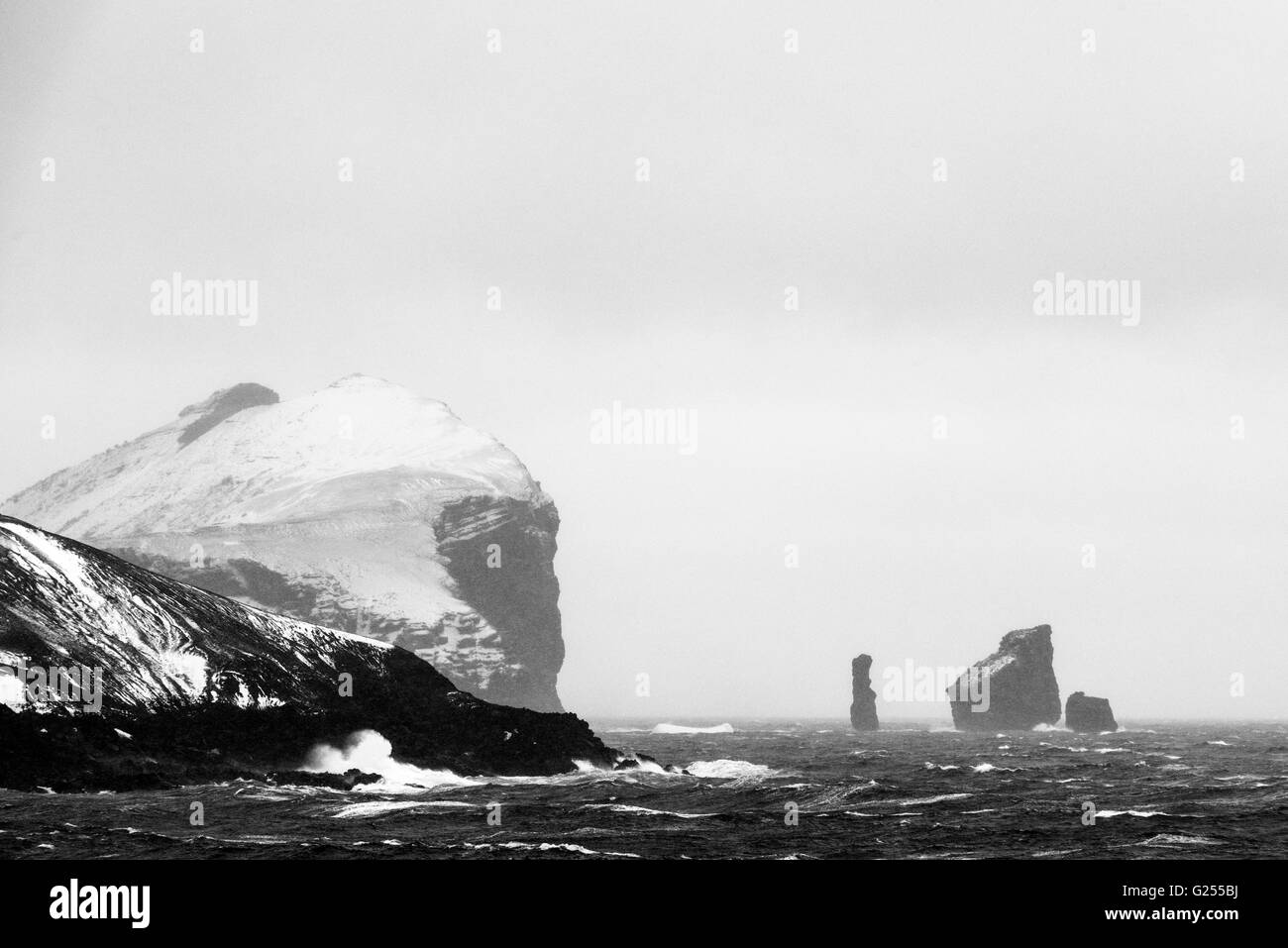 Rocks at the entrance to the caldera Deception Island, South Shetland Islands, Antarctica - Stock Image