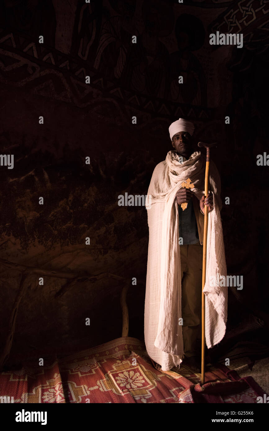 Orthodox Priest inside rock hewn church Gheralta, Ethiopia - Stock Image