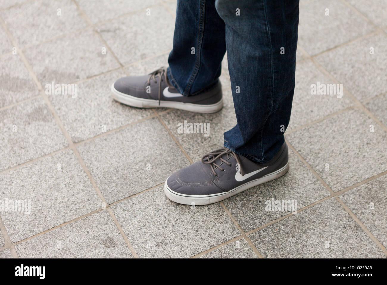 Man wearing Nike canvas shoes - USA - Stock Image