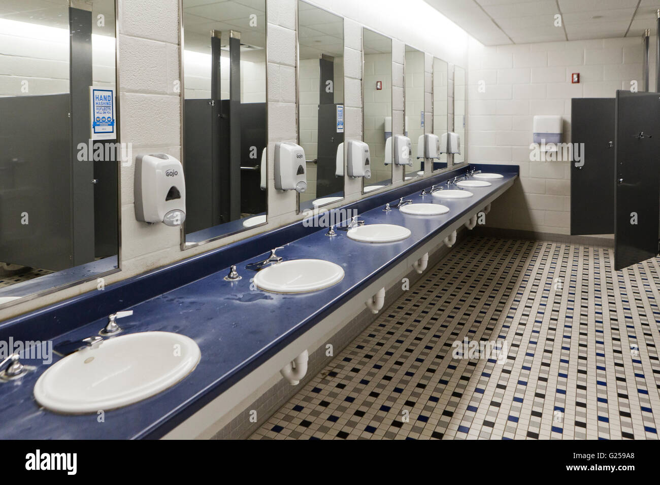 Mens room sinks - USA - Stock Image