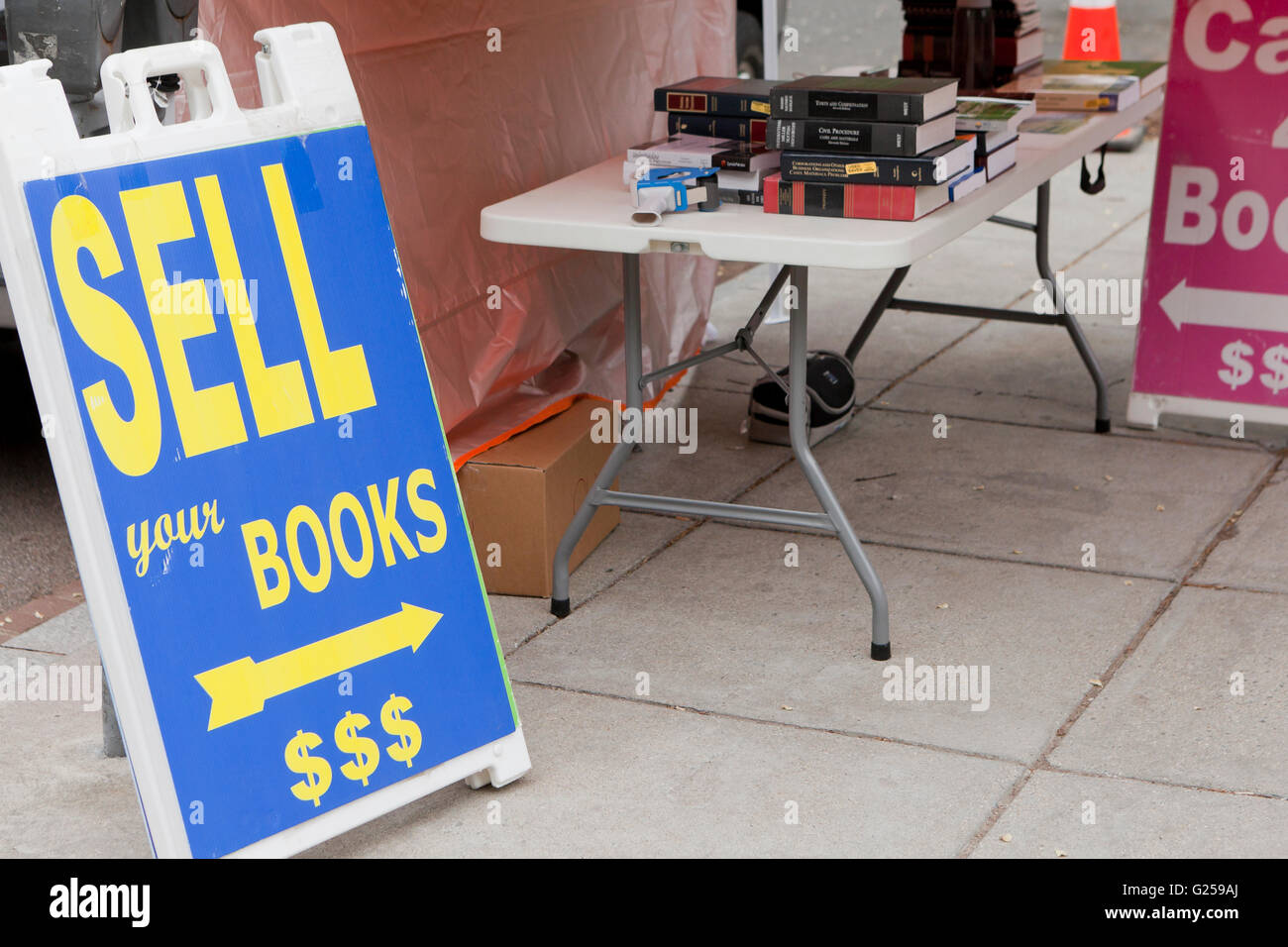 'Sell your books' sign at university - USA - Stock Image