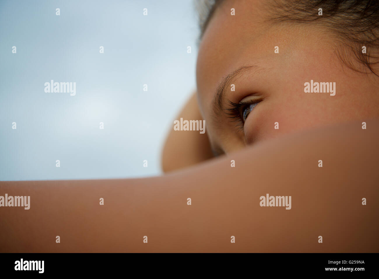 Close-up portrait of a woman looking ahead - Stock Image
