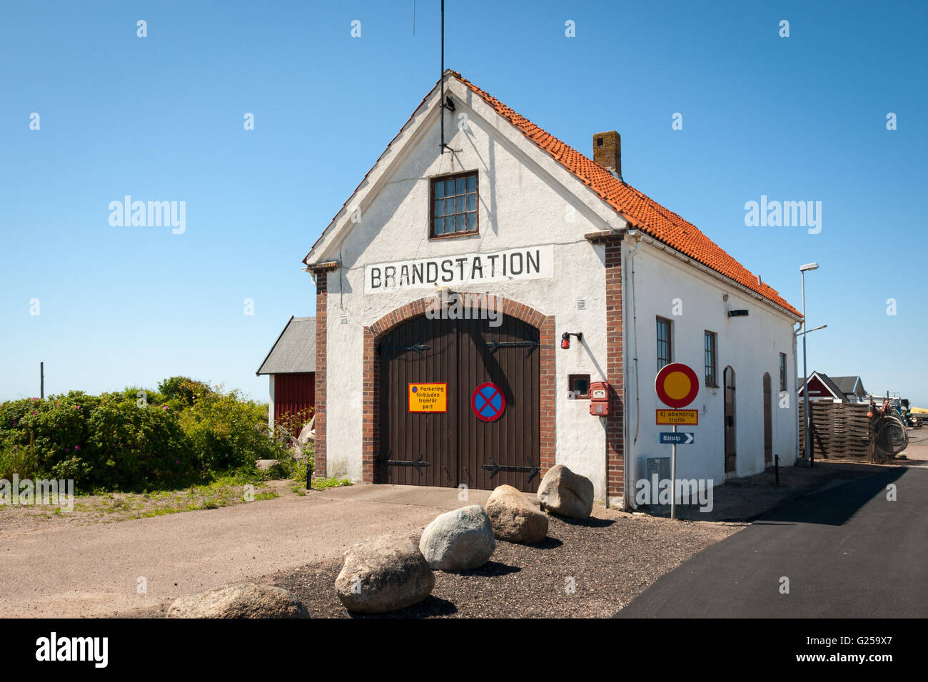 A view of the old fire station (brandstation) building at the port in Mölle, Sweden. - Stock Image
