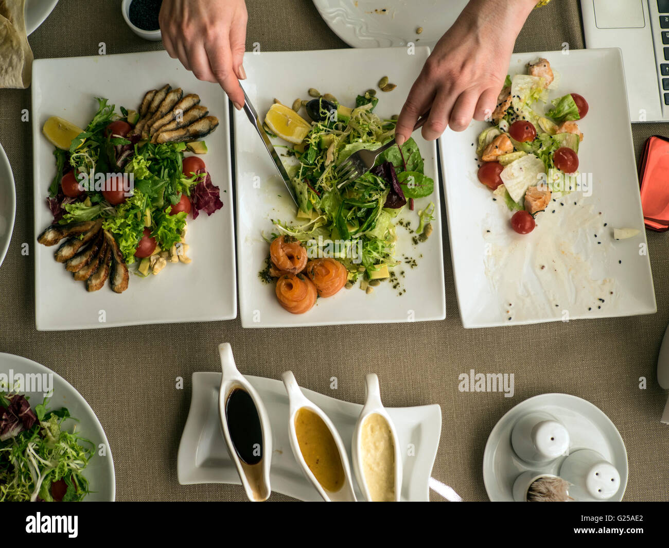 Woman eating salads in restaurant - Stock Image