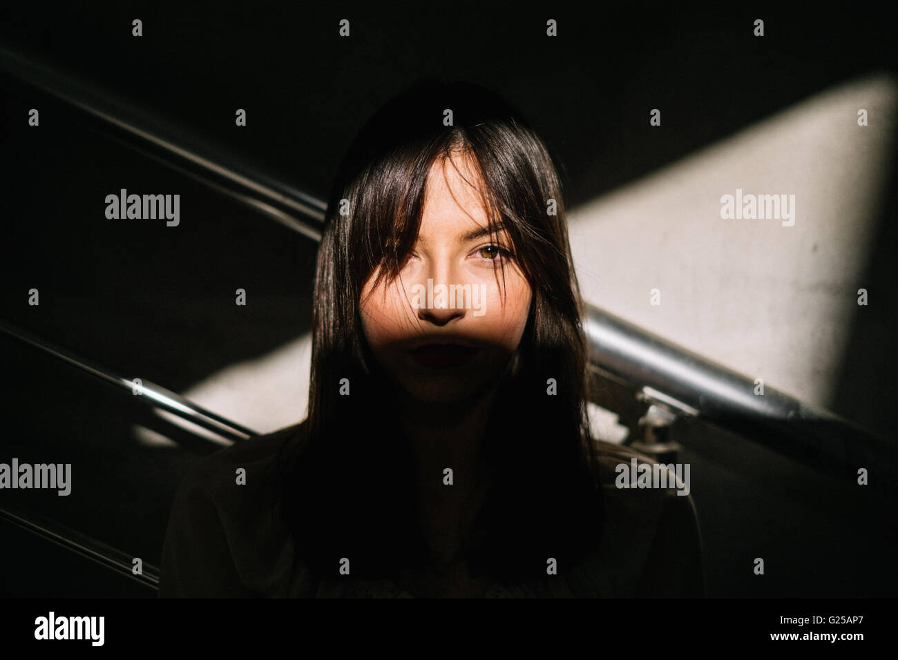Portrait of a woman's face in shadow - Stock Image