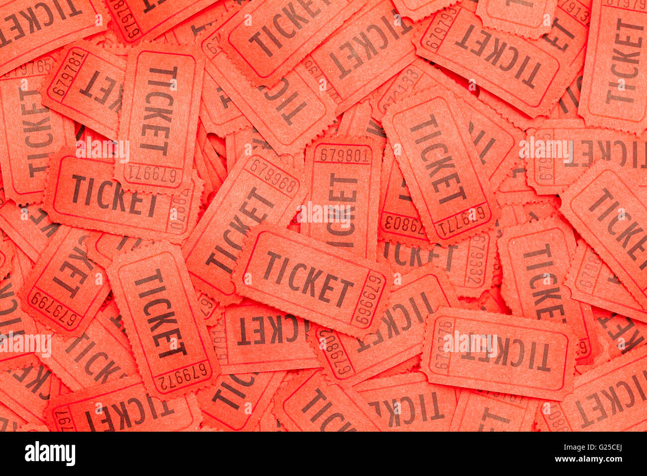 Large Pile of Messy Red Tickets Scattered About. - Stock Image