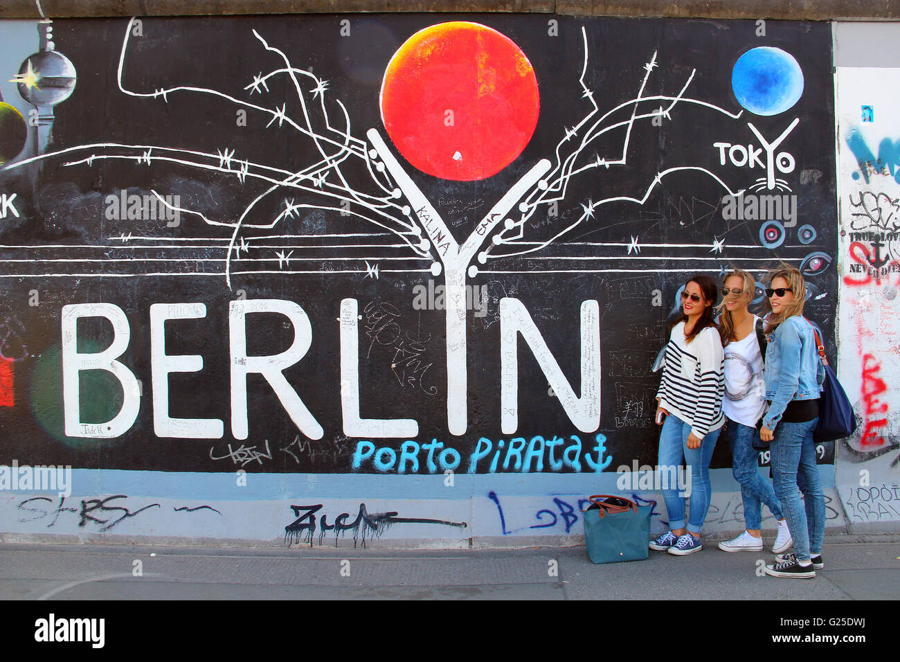East Side Gallery exhibition, the largest outdoor art gallery in the world, painted on the segment of Berlin wall - Stock Image