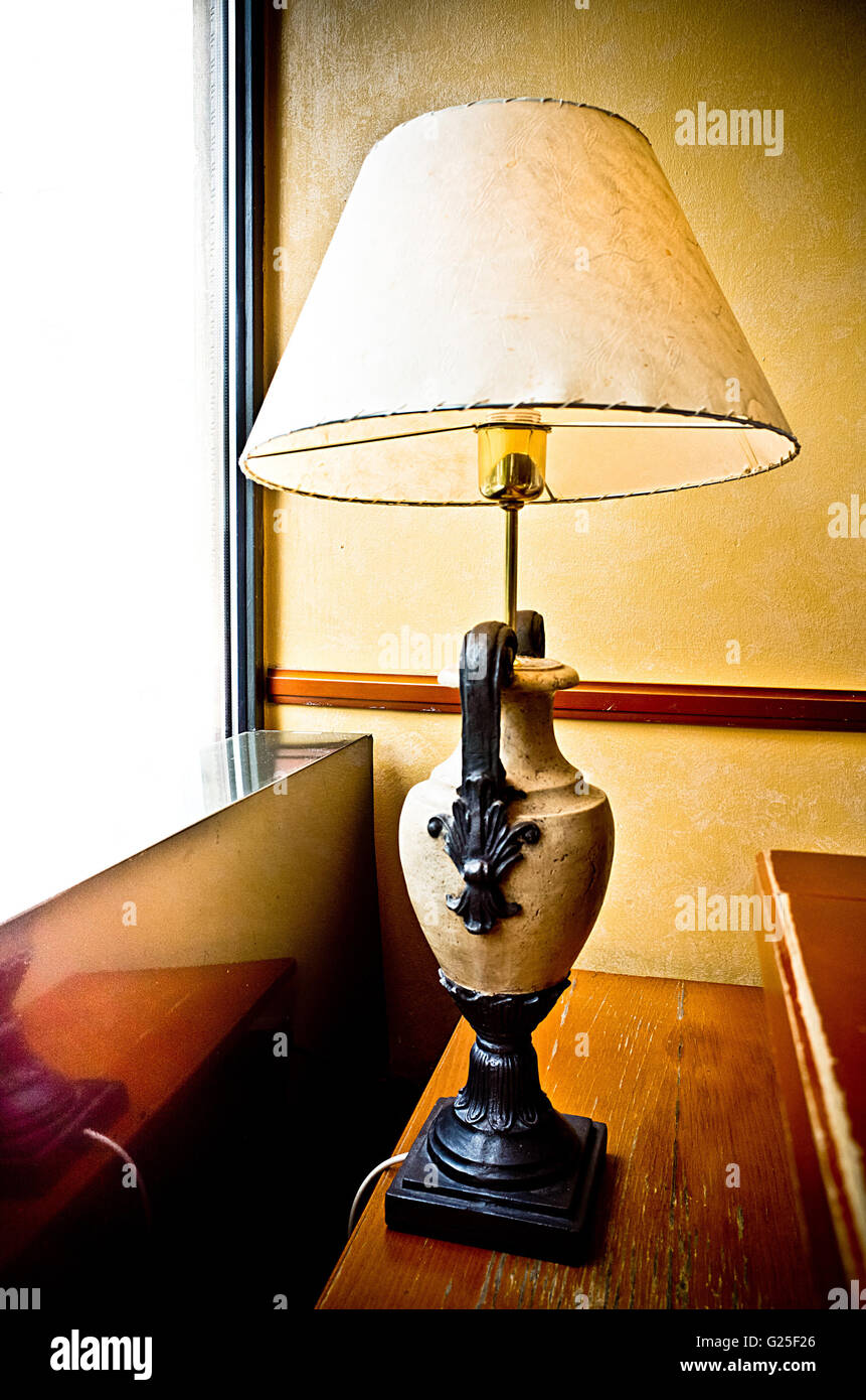 classic reading lamp on a table - Stock Image