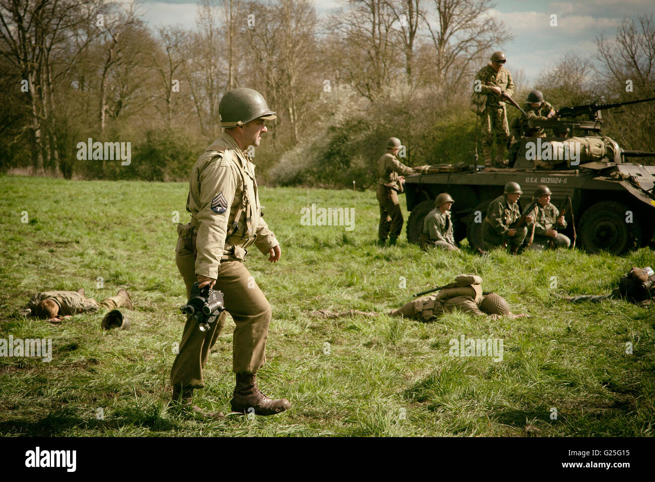 A world war two re-enactment in Oxfordshire, England. An allied war correspondent walks the battlefield. - Stock Image