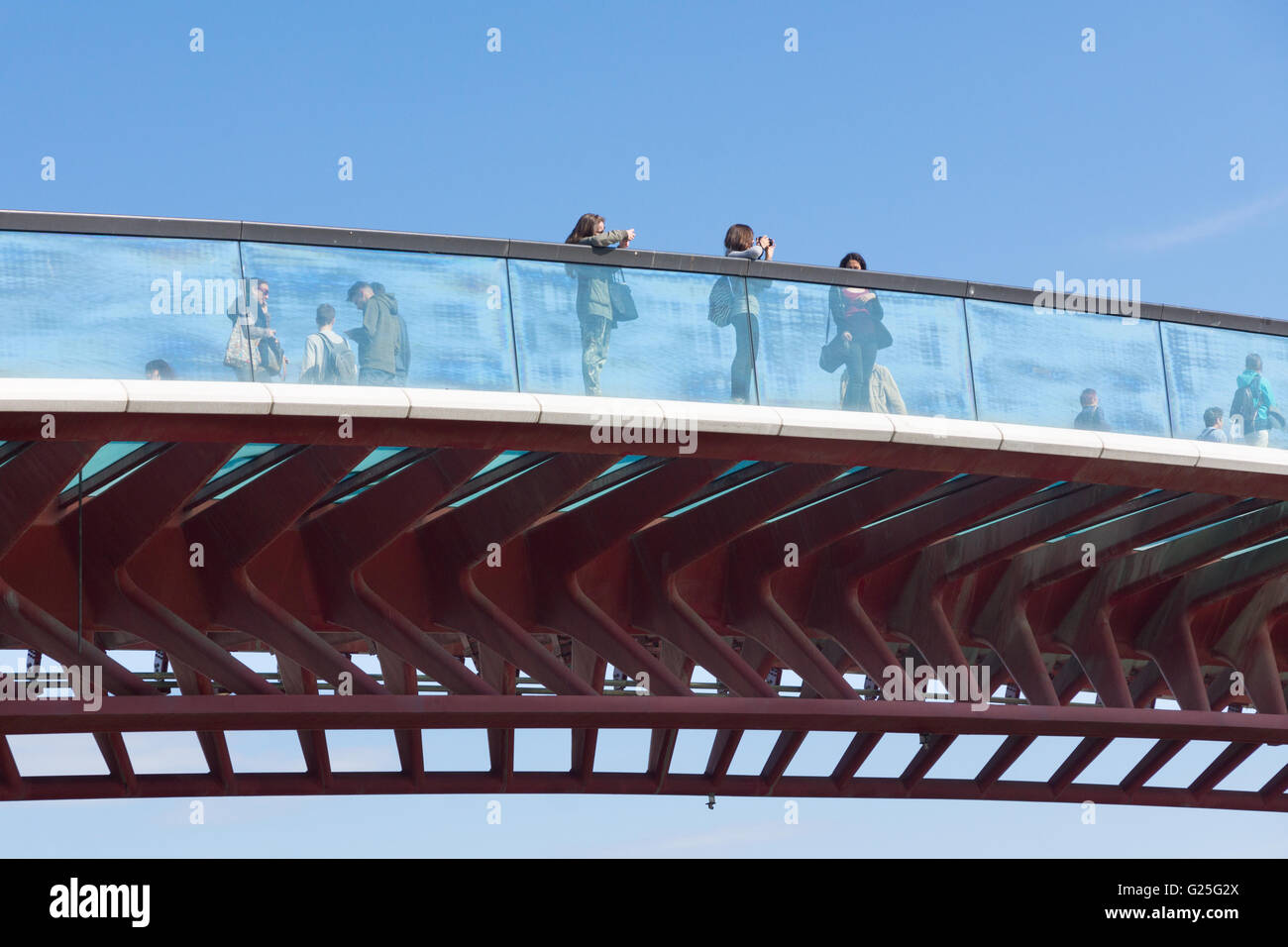 Pedestrians looking out at the view from the Constitution Bridge, Venice - Stock Image