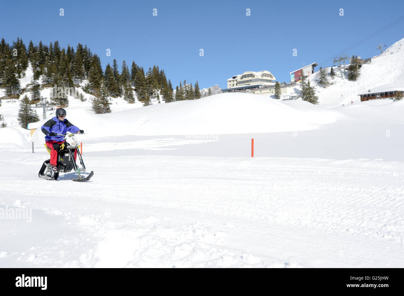 Engelberg, Switzerland - 7 March 2014: Men on snowmobile at Engelberg on the Swiss alps - Stock Image