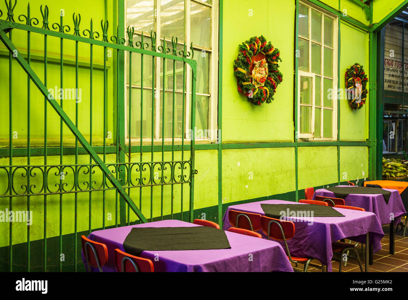 Tables at a restaurant in the city market at Valparaiso, Chile, South America. - Stock Image