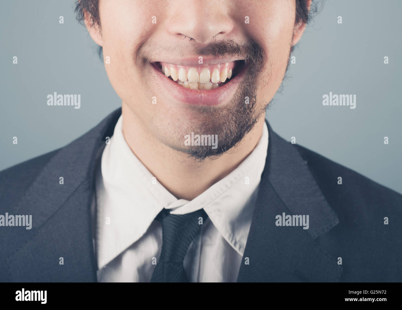 A young businessman with a half shaved beard - Stock Image
