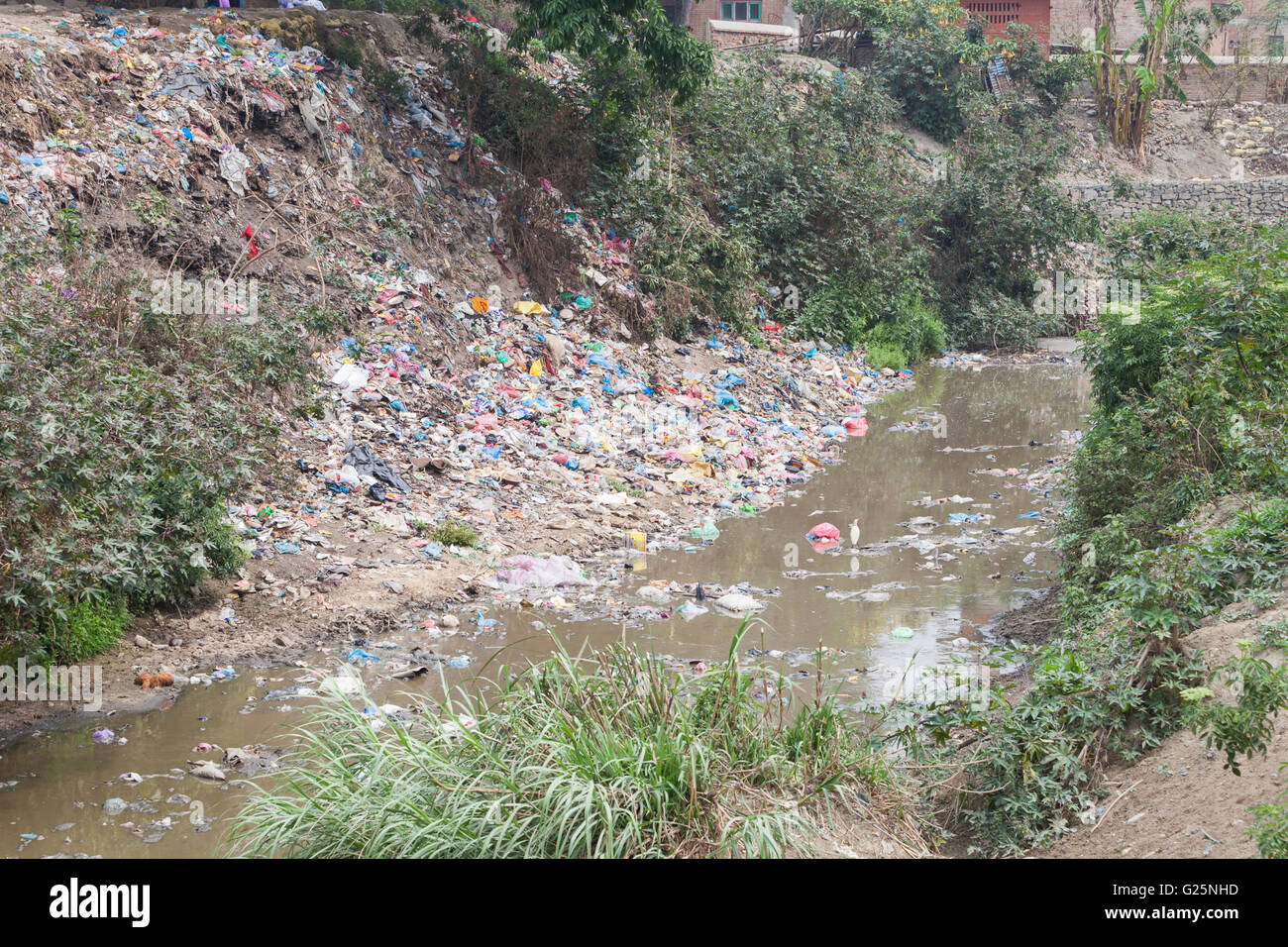 Rubbish dump along a river, Bhaktapur, Nepal - Stock Image