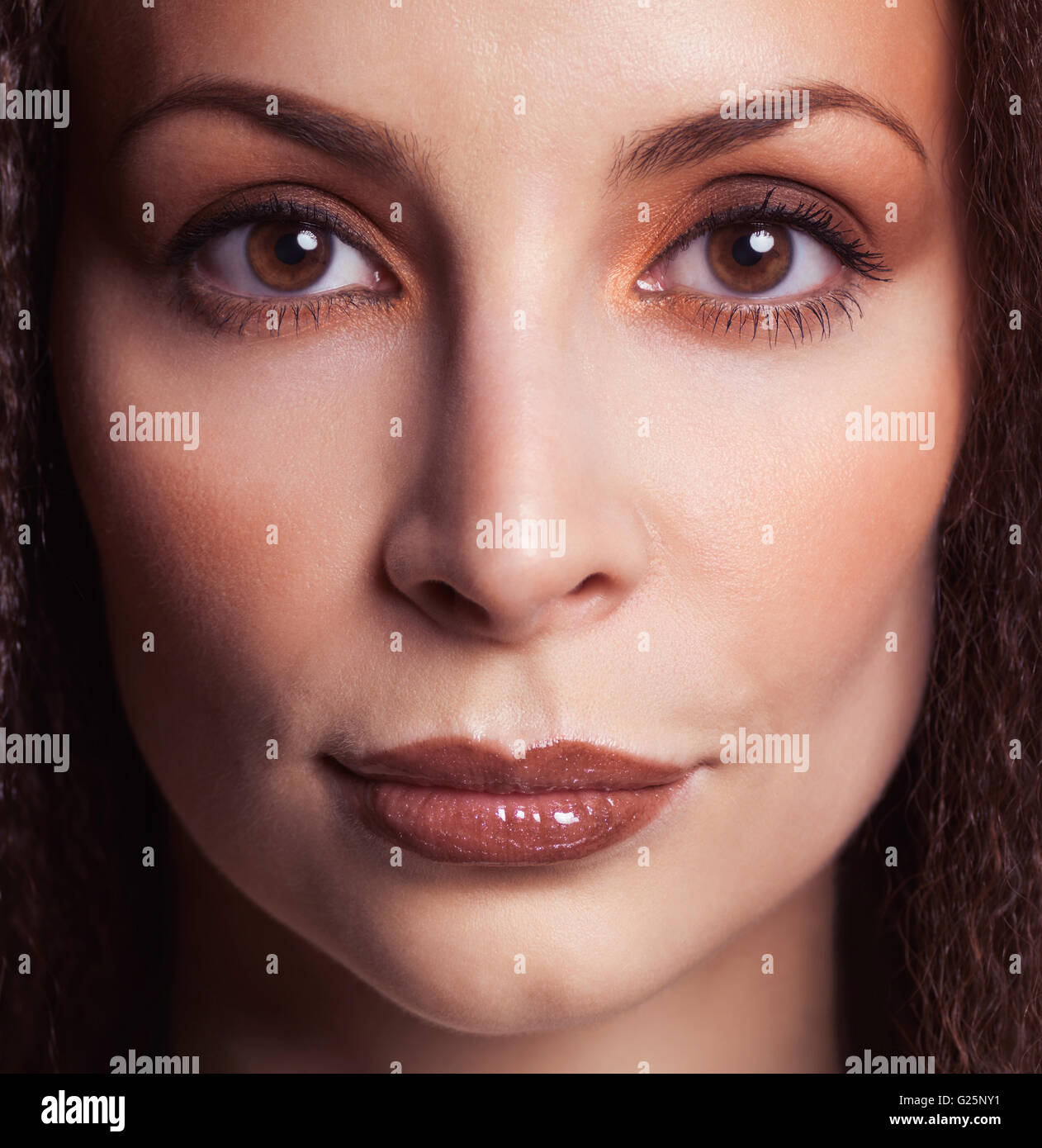 Woman's face wearing makeup - Stock Image