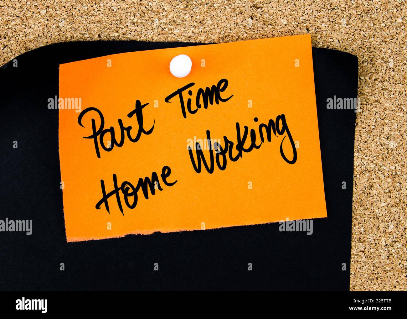 Part Time Home Working written on orange paper note pinned on cork board with white thumbtacks, copy space available - Stock Image