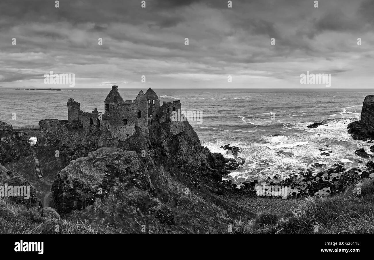 Dunluce castle on the County Antrim Coast and the Ulster Way and Causeway Coastal Route Northern Ireland - Stock Image