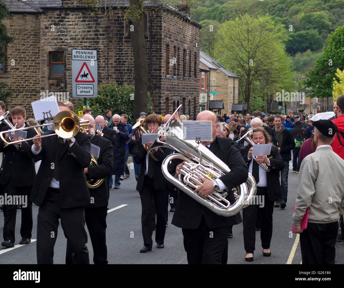 Brass band players march through Greenfield during the annual Saddleworth Whit Friday Band Contest. - Stock Image