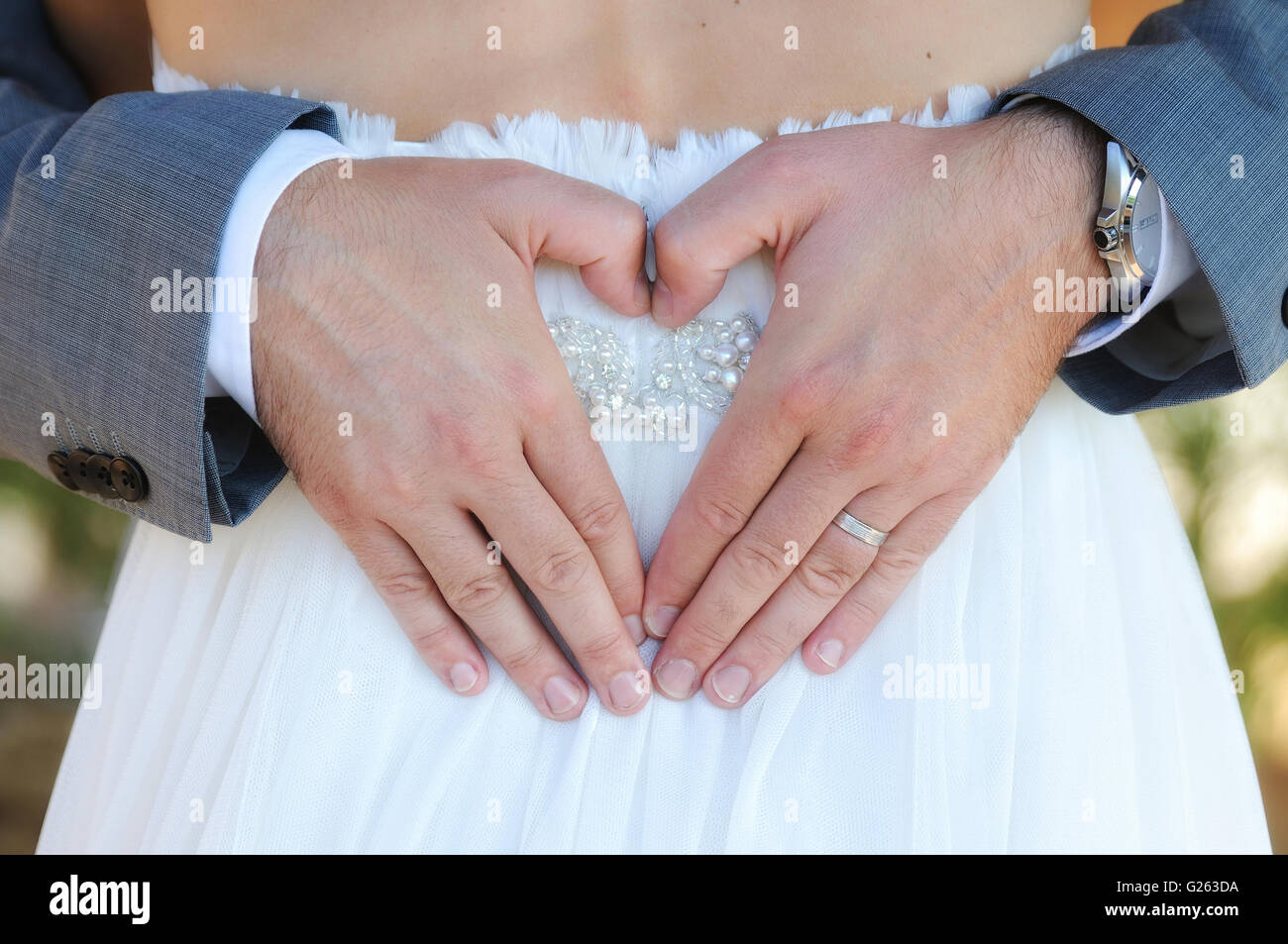 Bride Wearing Wedding Ring Hand Stock Photos & Bride Wearing Wedding ...