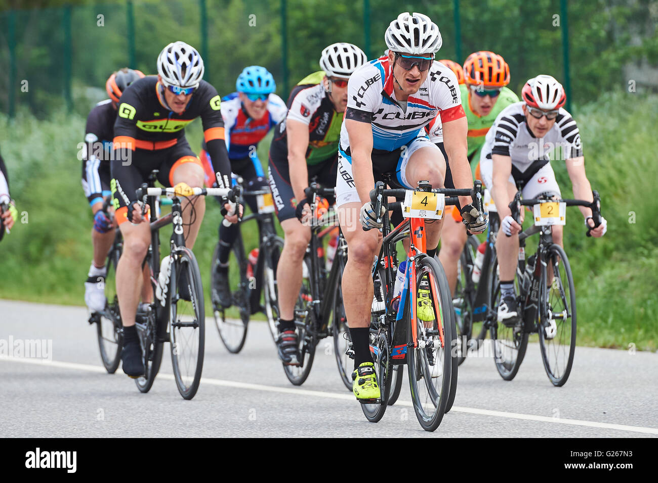 Cazis, Switzerland. May 24, 2016. Riders compete during the Criterium Race of the Cycling Grison Cup Series in Cazis. Stock Photo