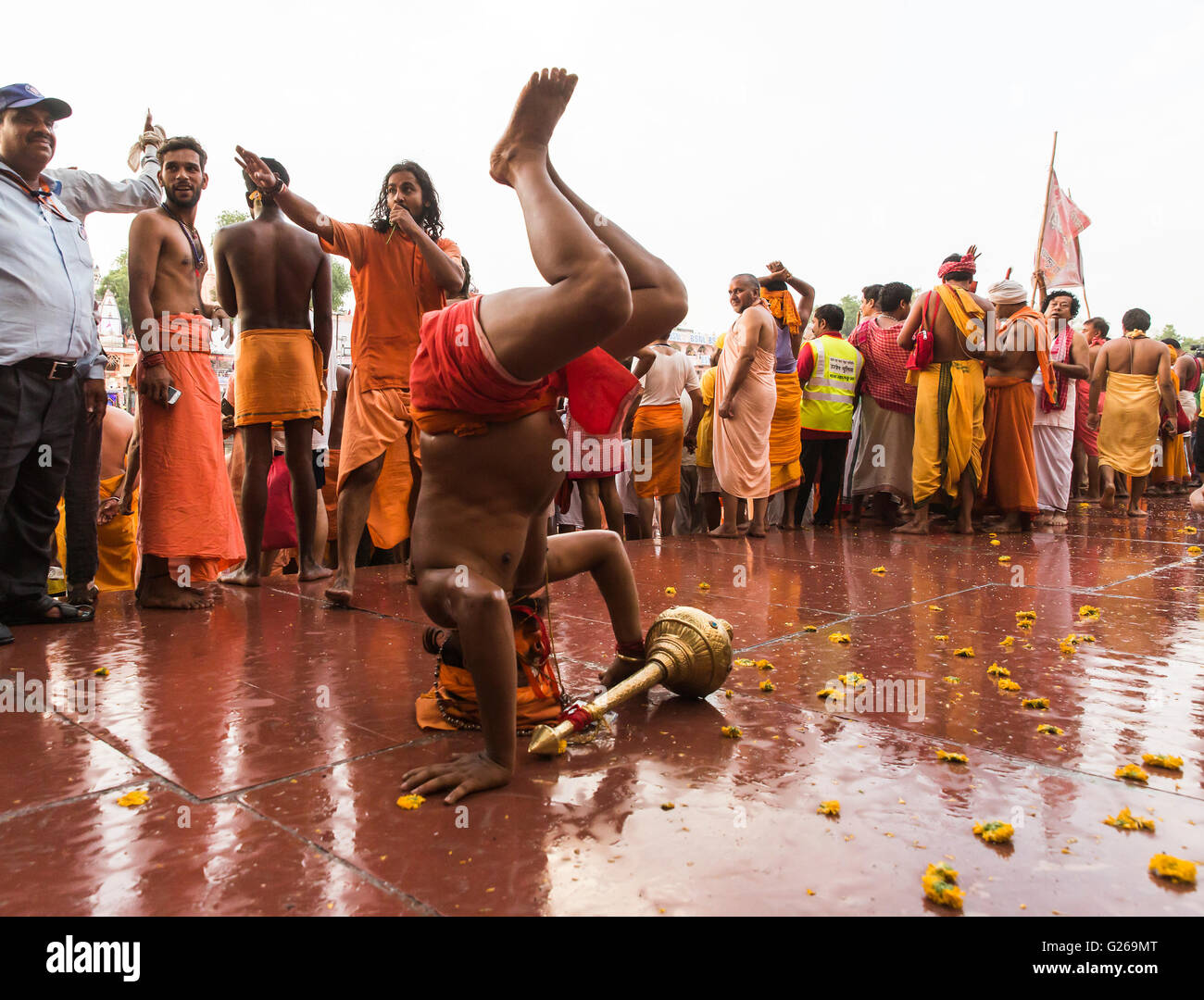 Ujjain, Madhya Pradesh, India, May 21, 2016: A Holy Hindu Monks (Naga Sadhu) is exhibiting the body fitness before - Stock Image
