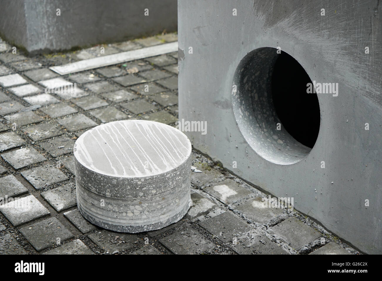 Berlin, Germany. 25th May, 2015. A sample of the core lays next to a stele of the Holocaust Memorial in Berlin, Stock Photo