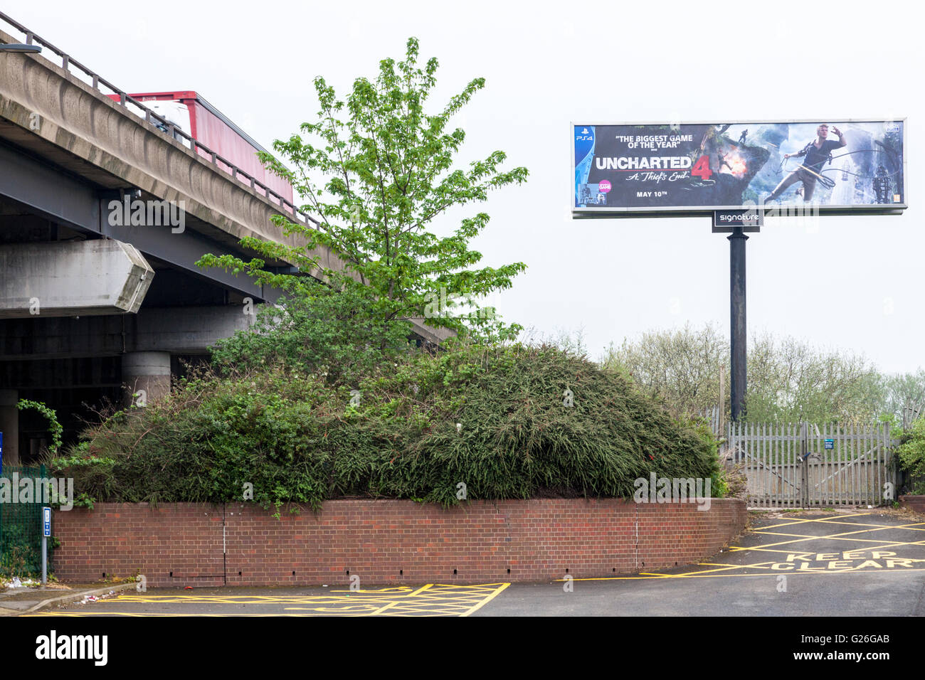 High level electronic advertising billboard next to the M6 motorway, Bescot, Walsall, West Midlands, England, UK - Stock Image