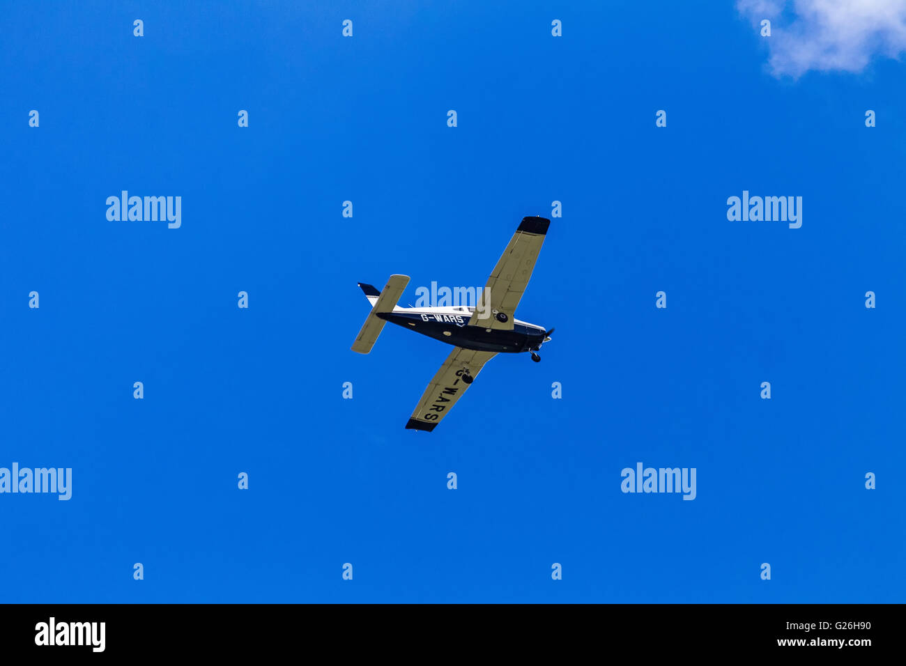Piper PA-28 G-WARS flying, in an almost cloudless blue sky, over Elstree Airfield, Hertfordshire, UK, prior to landing. - Stock Image