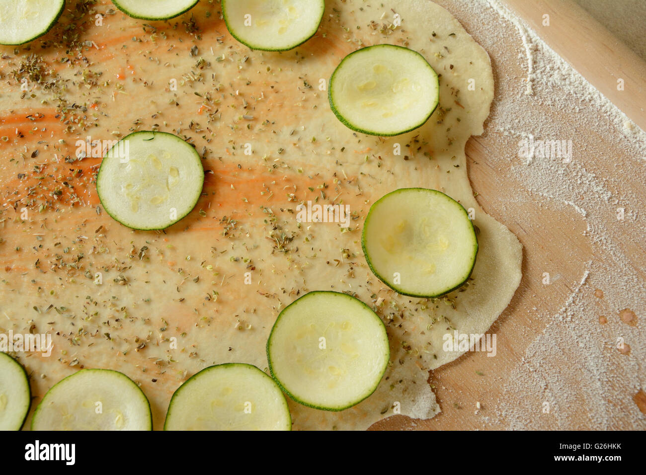 Home made raw pizza during preparation. - Stock Image