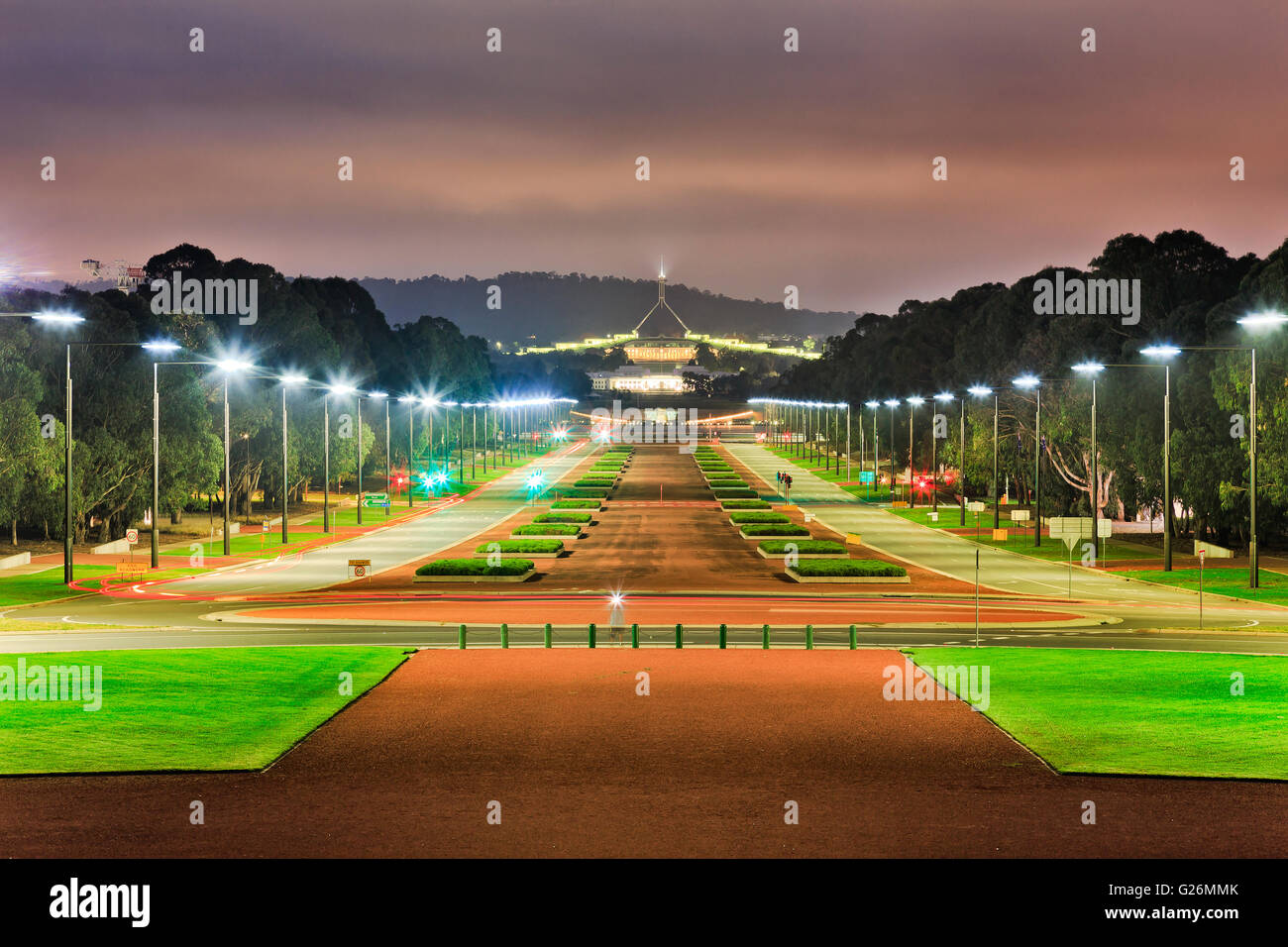 ANZAC parade wide road and street with bright illumination by light poles at sunrise in Canberra, Australia capital - Stock Image
