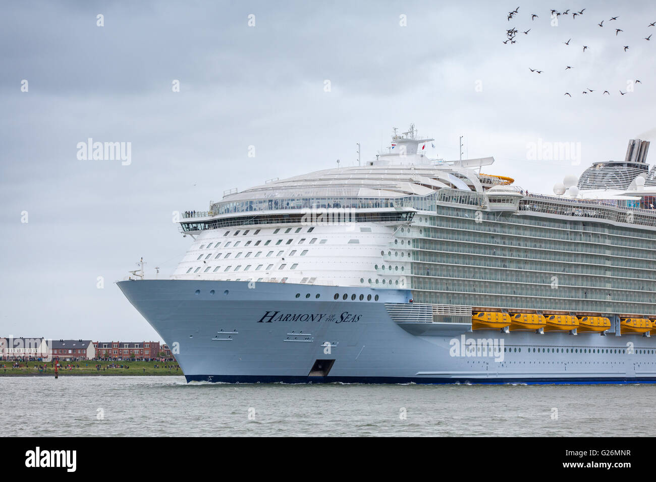 World's biggest cruise ship Harmony of the Seas leaves port of Rotterdam Netherlands for the remainder of  it's - Stock Image