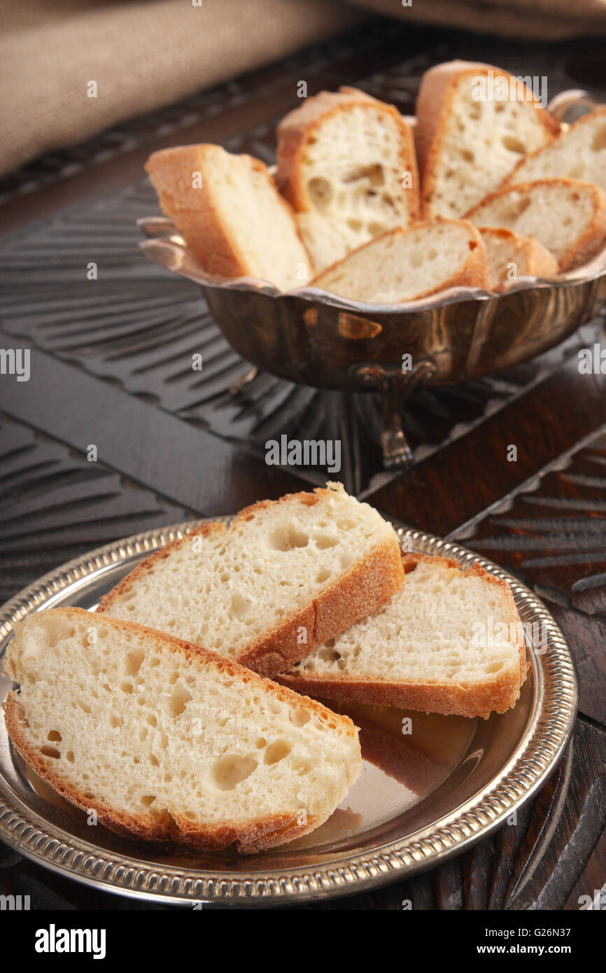 Bread slices on a wooden table - Stock Image