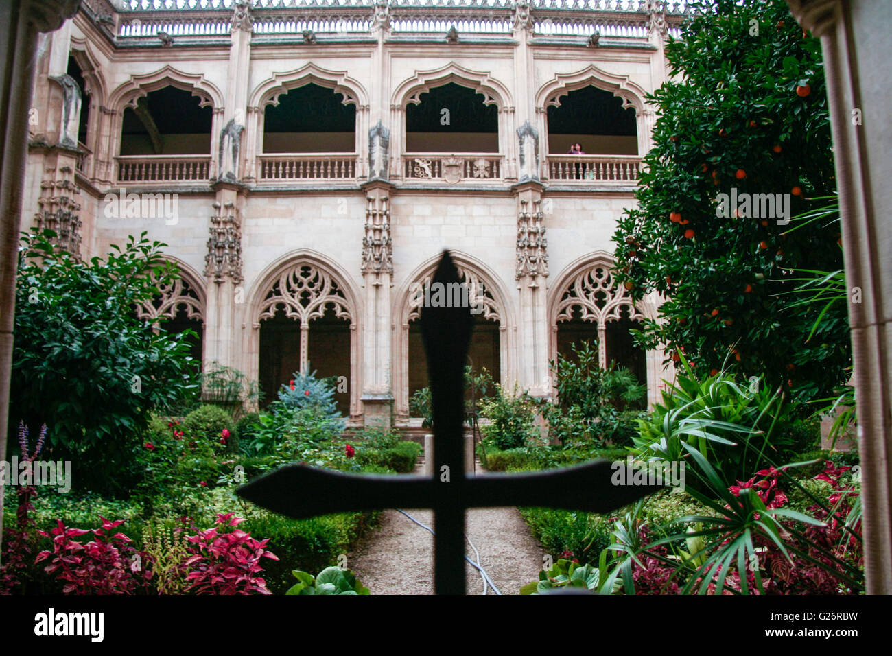 Toledo, Spain -   September 30, 2007: Gothic atrium of Monastery San Juan de los Reyes  Cross - Stock Image