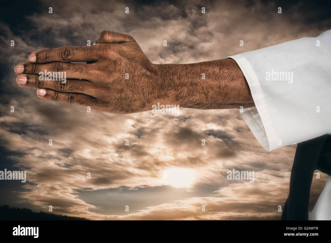 Composite image of close up view oh hands - Stock Image