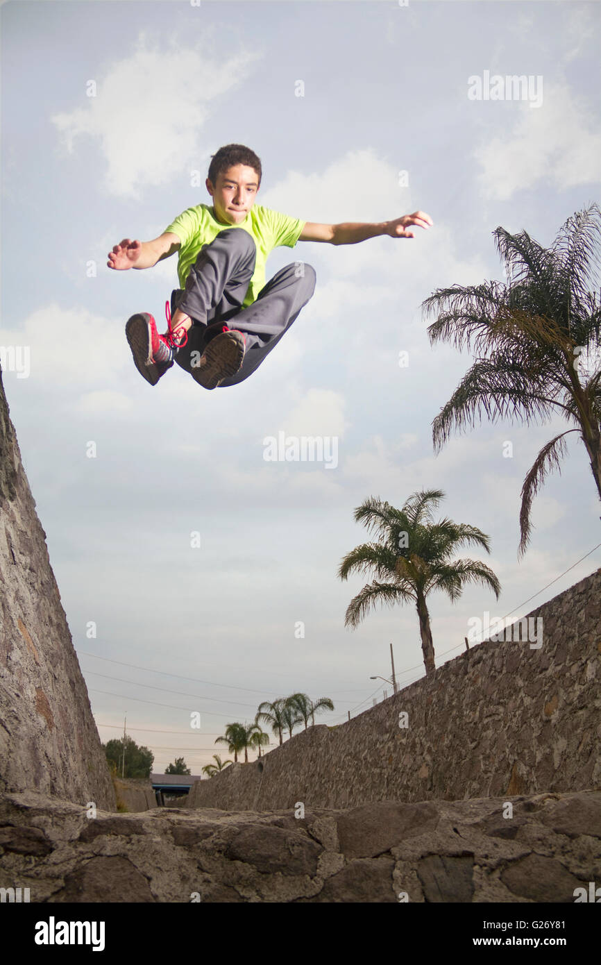 Front parkour jump in a waterway - Stock Image