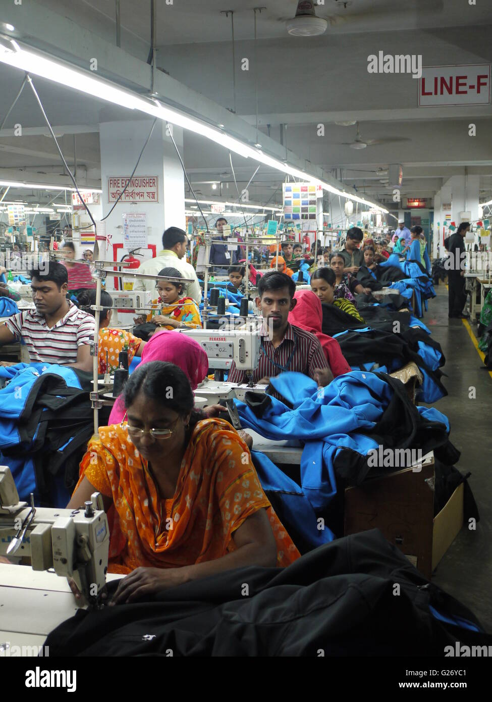 Workers of garment sector in Bangladesh inside a factory in Dhaka - Stock Image