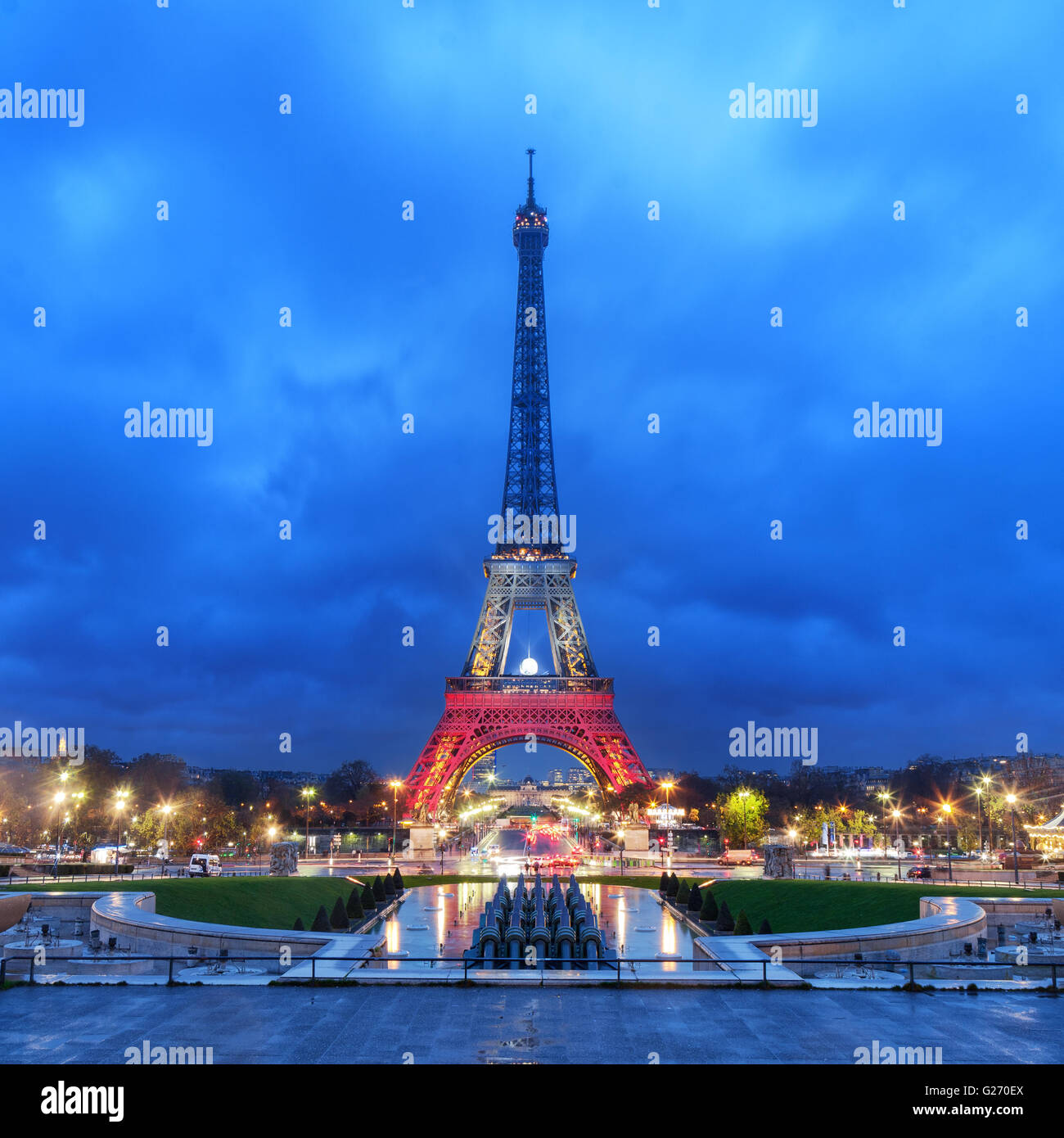 PARIS, FRANCE - NOVEMBER 20, 2015: Eiffel tower illuminated with colors of French national flag after November 13 - Stock Image