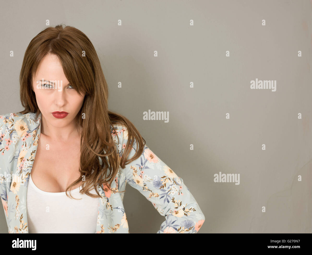 Portrait of an Angry Unhappy woman With Issues on Her Mind Looking At The Camera Frowning With Copy Space - Stock Image