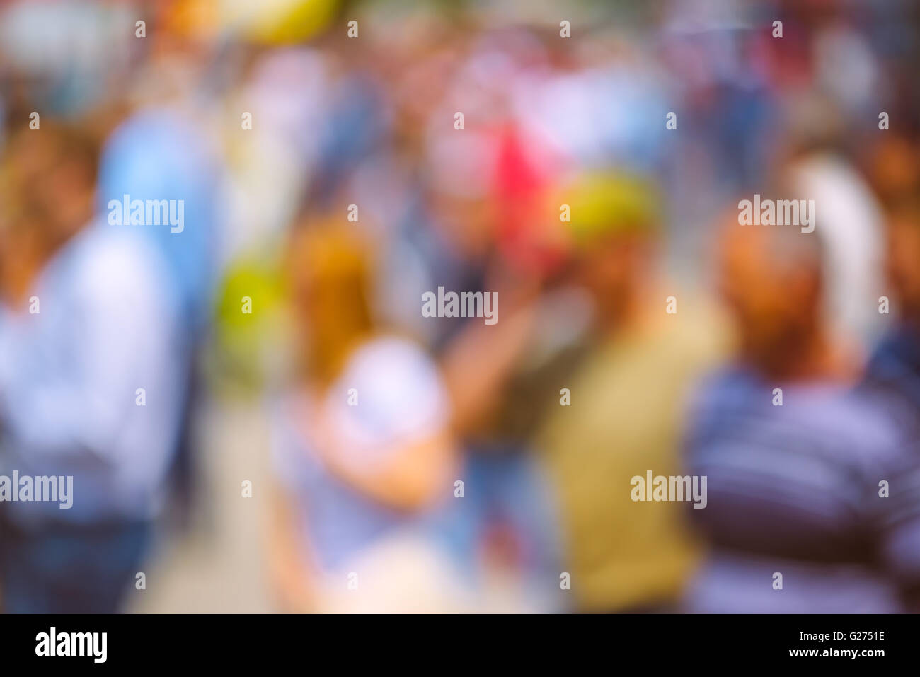 Abstract blur crowd of people on the street, unrecognizable everyday ordinary men and women as blur urban background. - Stock Image