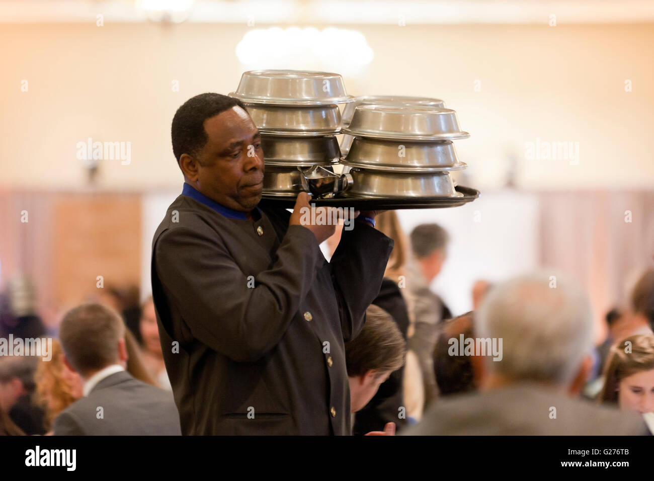 Hotel banquet server - USA - Stock Image