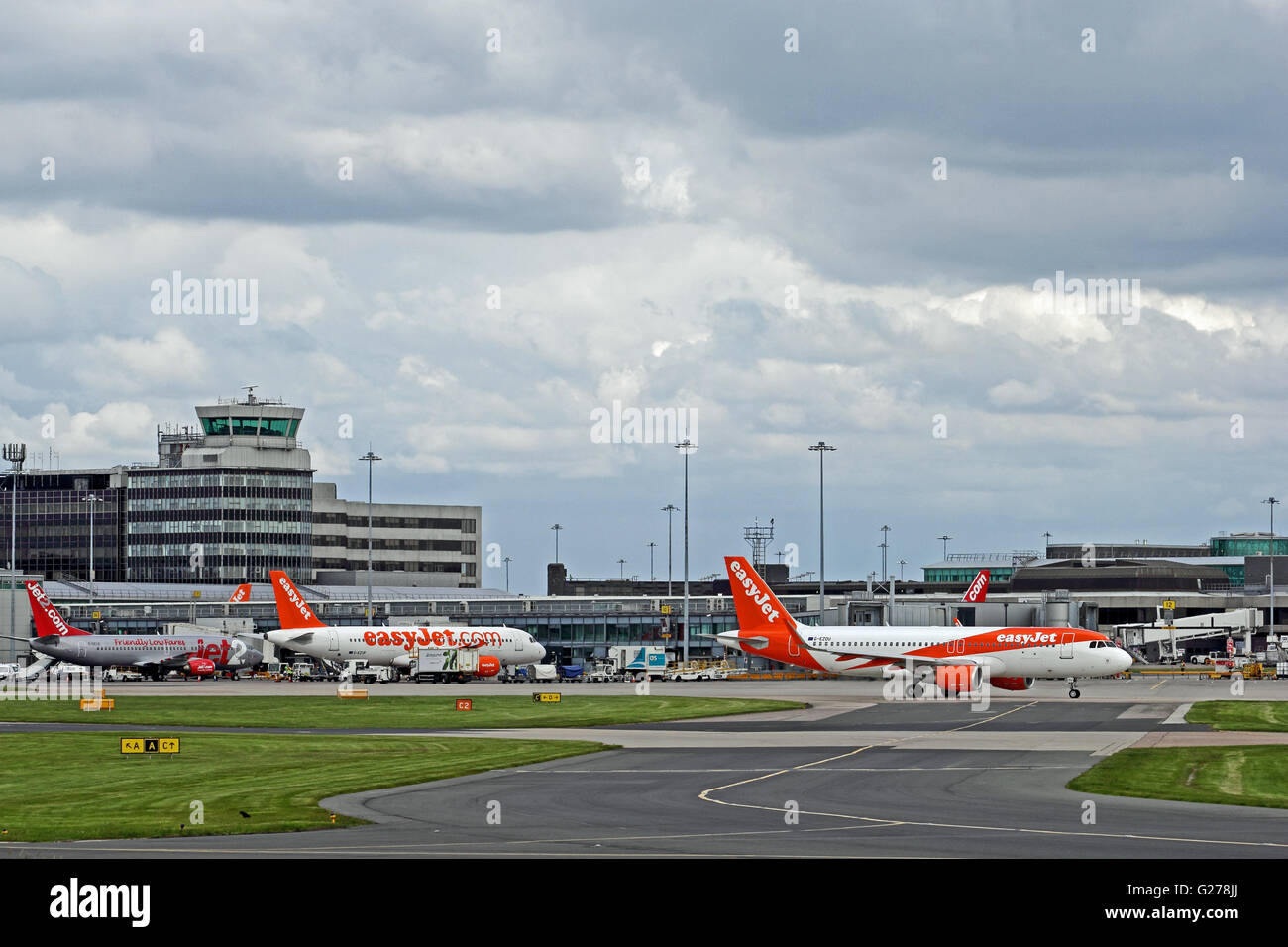 Easyjet airliners at terminal at Manchester International Airport - Stock Image