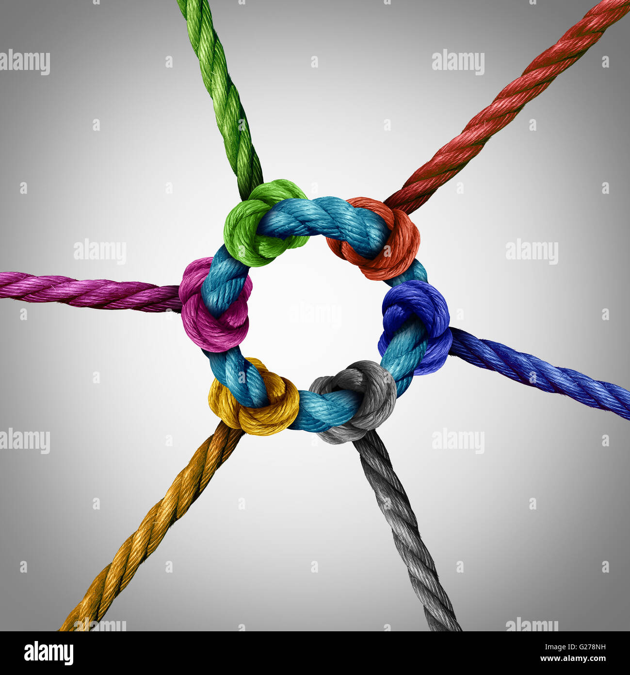 Central network connection business concept as a group of diverse ropes connected to a circle central rope as a - Stock Image