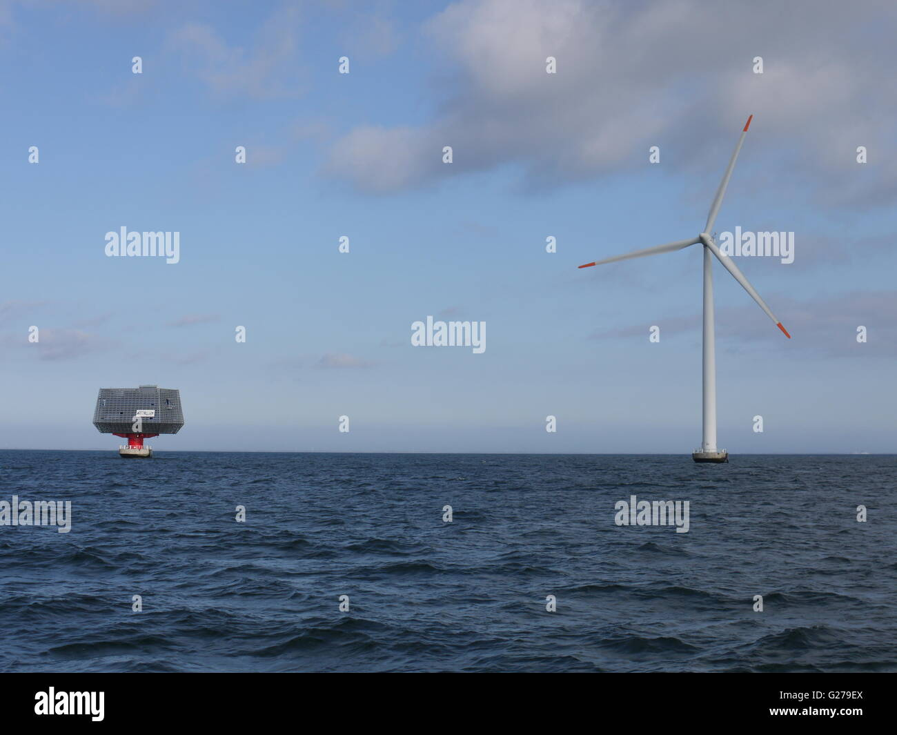 Off shore wind turbine and sub-station in south of Denmark for production of sustainable electricity - Stock Image